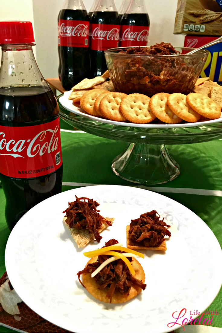 Make your own Coca-Cola Pulled Pork! This slow cooker recipe will knock your socks off. It's super easy and bursting with flavor. Appetizer or main dish.