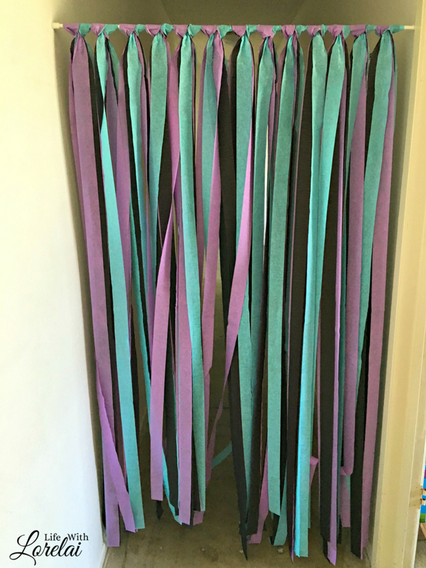 Party Decor doesn't have to be expensive or hard to make. Give these simple DIY Room Dividers a try. It's made with streamers and a tension rod.