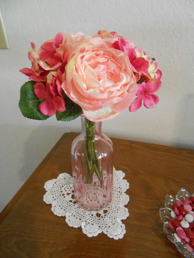 Rose and Hydrangea Flowers in Pink Vase